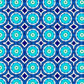 blue white kaleidoscope circles tell3people