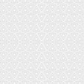 Layered triangles in grey and white
