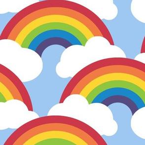 large circle rainbow - blue skies