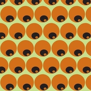 orange circles in circles on green
