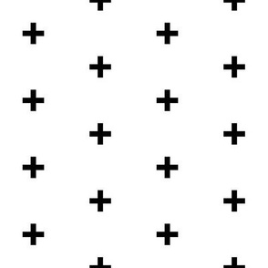 black cross on white brick pattern