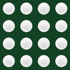 "1"" golf ball on forest green"