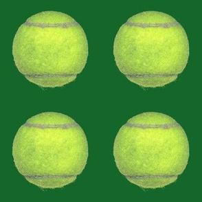 "4"" tennis balls on green"