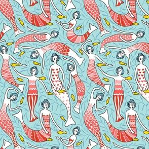 Elegant mermaids swimming in the ocean