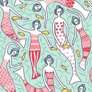 mermaids feeding the fish