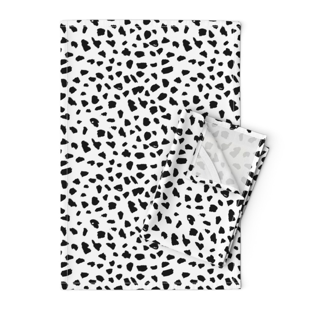 Orpington Tea Towels featuring Black and white abstract dalmatian spots and dots leopard animal skin organic trendy gender neutral geometric print by littlesmilemakers