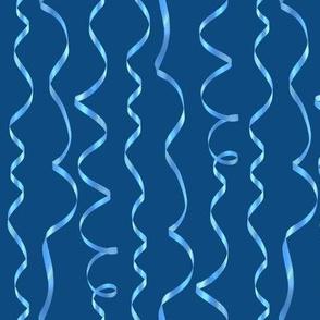 blue curling ribbons on dark blue