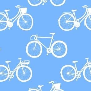 white bikes on blue