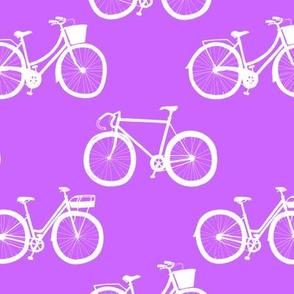 white bikes on purple