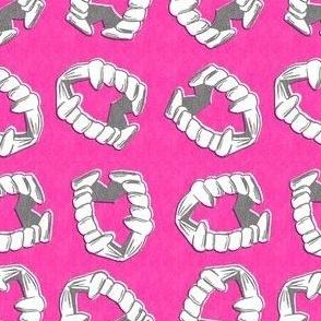 vampire teeth hot pink