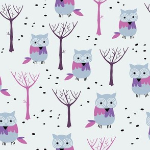 Owls in the winter forest