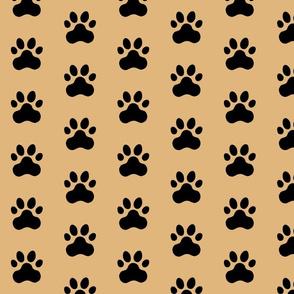 Pawprint Polka dots - 1 inch (2.54cm) - Black (#000000) on Light Brown (#E0B67C)