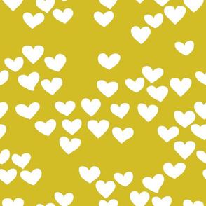 Pastel love hearts tossed hand drawn illustration pattern scandinavian style in mustard yellow