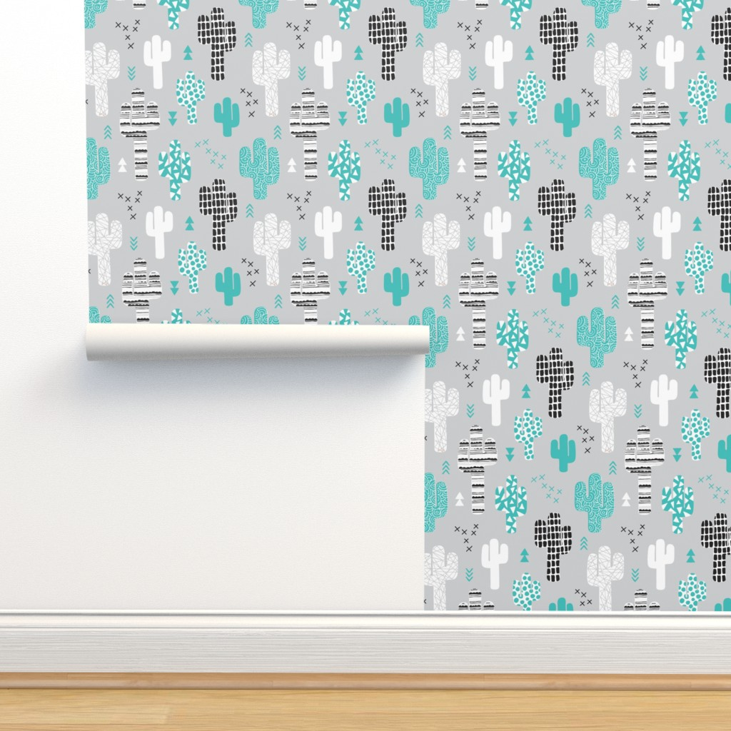 Isobar Durable Wallpaper featuring Cool western geometric cactus garden with triangles and arrows gender neutral pastel blue black and white by littlesmilemakers