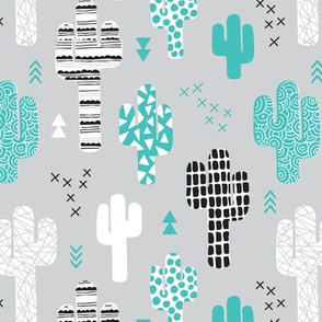 Cool western geometric cactus garden with triangles and arrows gender neutral pastel blue black and white