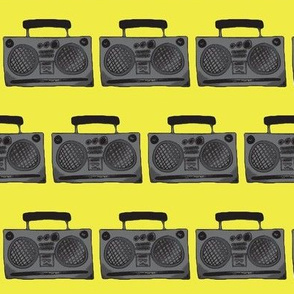 Boom boxes on yellow