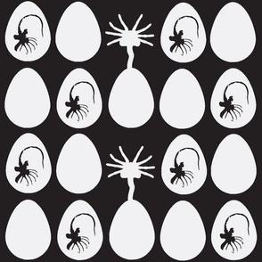 Mini eggs and facehuggers-black bg and white eggs
