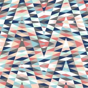 patchwork arrow - coral, grey, blue