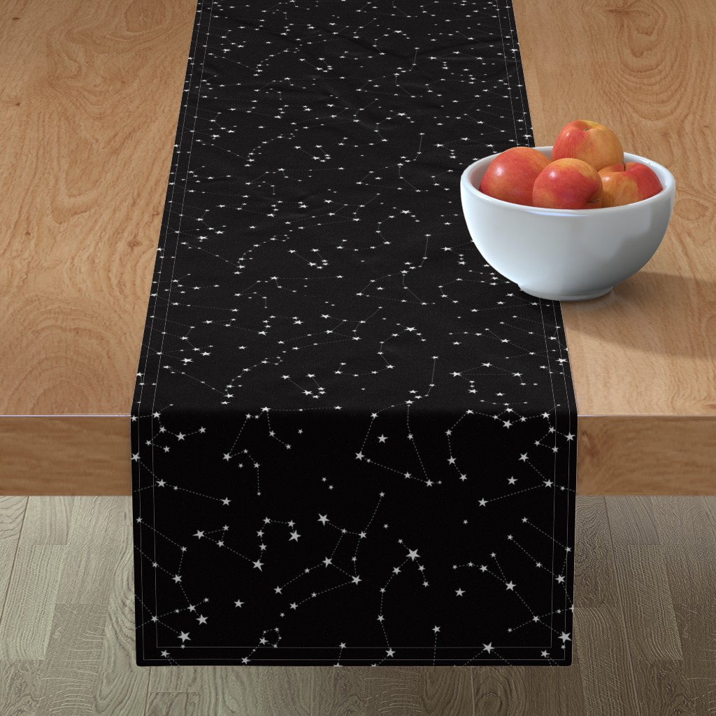 Minorca Table Runner featuring stars in the zodiac constellations on black by eleventy-five