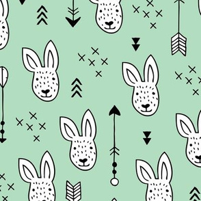 Cool white bunny and geometric arrows spring easter design in gender neutral mint green