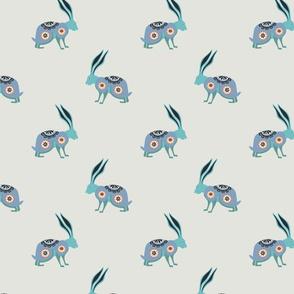 folk art rabbits/hares on cream