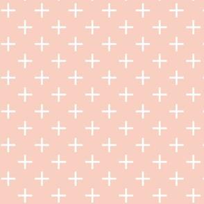 cross / plus on peach