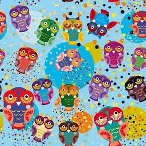 colorful owls on a blue background.