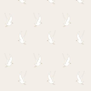 Seagulls in flight on taupe