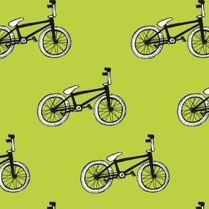 Black and white bicycles on green