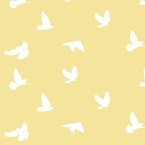 Doves in Flight on Straw Yellow