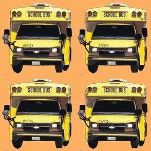 little yellow school bus on peach