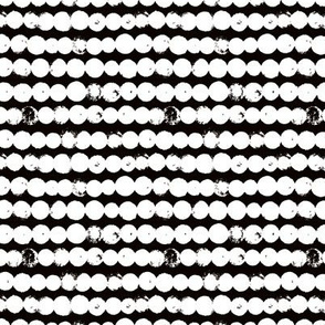 Circles and rows cool Scandinavian style dots brush strings gender neutral black and white