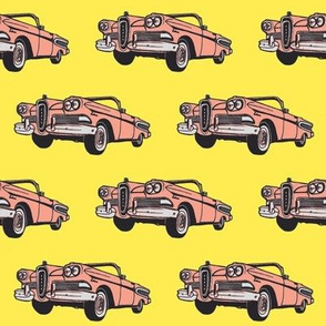 Sunset Coral 1958 Edsel Citation convertible on yellow background