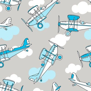 Planes and clouds on grey