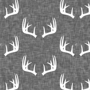 antlers on grey linen