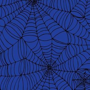 Spiderwebs - black on bright blue
