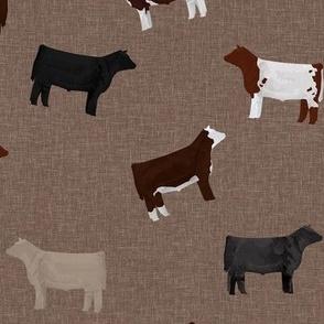 Mixed cattle on tan linen