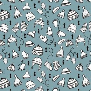 Ice cold winter season mittens and hats geometric kids illustration pattern design ice blue