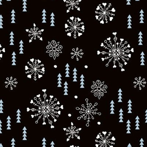 Pine trees and snow flakes winter wonderland and christmas holidays theme black ice blue