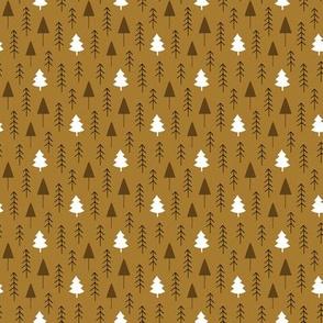 Alpine winter forest on brown