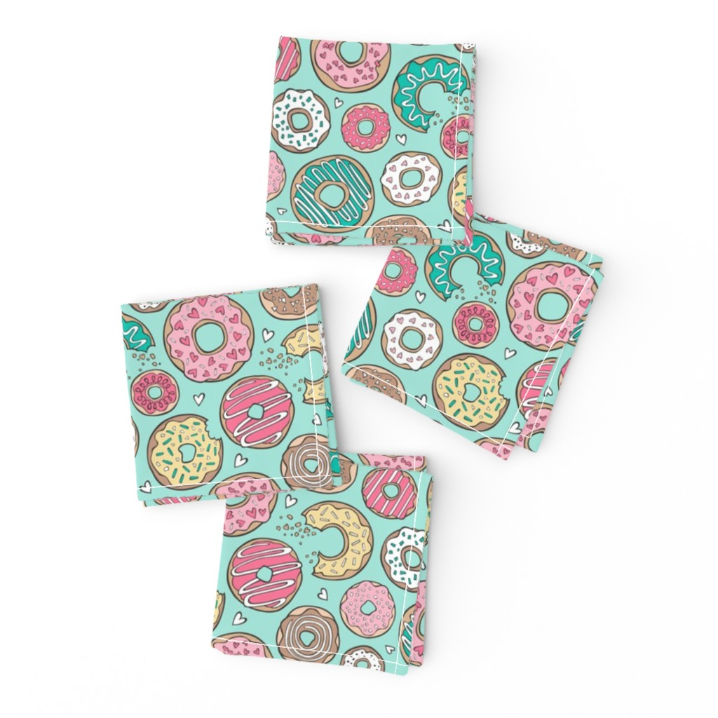 Frizzle Cocktail Napkins featuring Donuts with Hearts Yellow, Green, Pink and Chocolate on Mint by caja_design