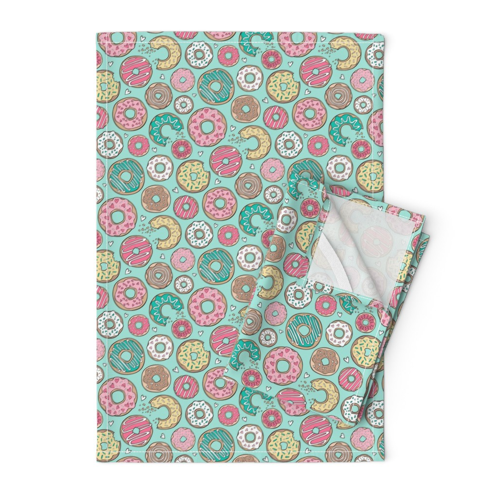 Orpington Tea Towels featuring Donuts with Hearts Yellow, Green, Pink and Chocolate on Mint by caja_design