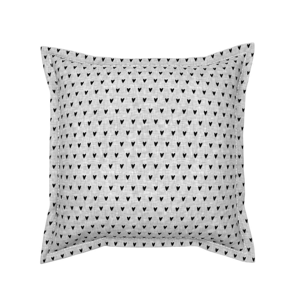 Serama Throw Pillow featuring black hearts on light grey linen by littlearrowdesign