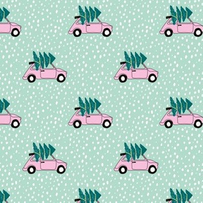 Driving home for Christmas Vintage Fiat 500 christmas tree winter snow wonderland pink