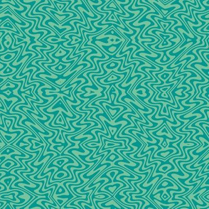 small butterfly ripples in surf teal