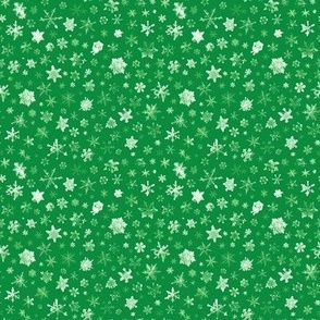 photographic snowflakes on Christmas green (small snowflakes)