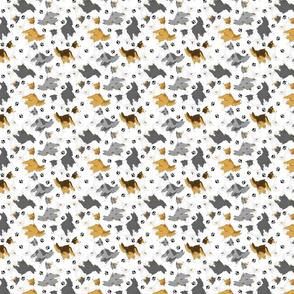 Trotting Shelties and paw prints - tiny white