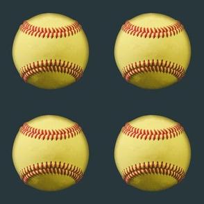 "3"" yellow softballs on dark grey"
