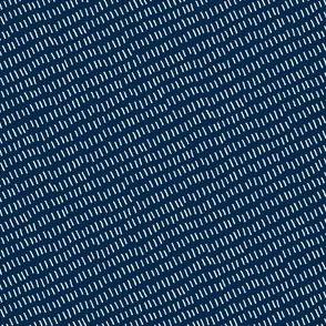 diagonal white stitches on blue