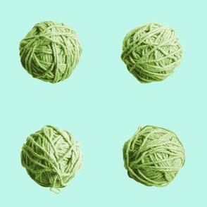 little yarn balls - fresh green on pale aqua